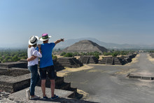 Couple Overlooking Pyramid Of ...