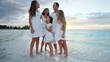 Caucasian family barefoot on a beach together at sunset