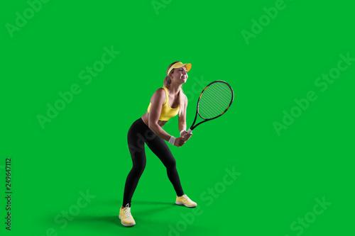 Girl tennis player on green background. Fototapeta