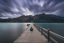 After Sunset, The Moon Is Rising At Glenorchy Wharf. Glenorchy Is A Charming Touristic Village Situated At The Northern End Of Lake Wakatipu, Otago Region, Queenstown, New Zealand South Island.