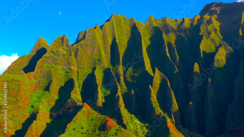Wall Murals Pale violet Hawaii travel aerial background of Na Pali coast, Kauai, Hawaii helicopter view. Nature coastline landscape in Kauai island, Hawaii, USA. Panoramic banner crop