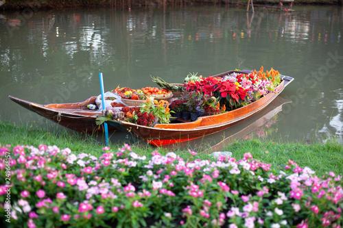 Flower boat in the garden. Canvas Print
