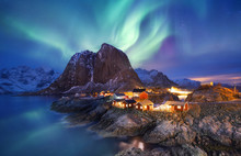 Aurora Borealis On The Lofoten Islands, Norway. Green Northern Lights Above Ocean. Night Sky With Polar Lights. Night Winter Landscape With Aurora And Reflection On The Water Surface. Norway-image