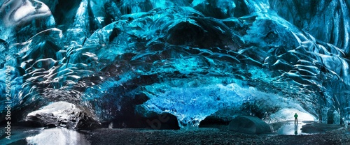 Fotografie, Obraz Blue crystal ice cave and an underground river beneath the glacier