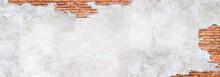 Antique Brick Wall Under Damaged Plaster. Weathered Brickwork Texture With Cracked Concrete