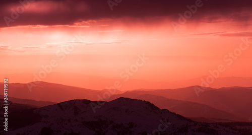 Poster Corail sunset in the mountain with mystic light and clouds