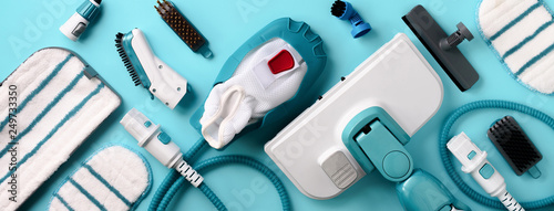 Fototapeta Set with modern professional steam cleaners on blue background. Top view, flat lay. Banner with copy space. Cleaning service concept obraz