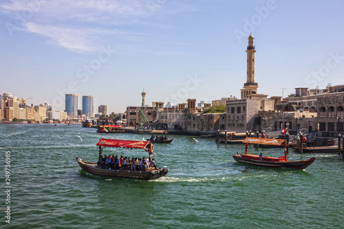 Dubai, UAE - Feb 15, 2019: Tourist boats abra on canal Dubai Creek and old town.