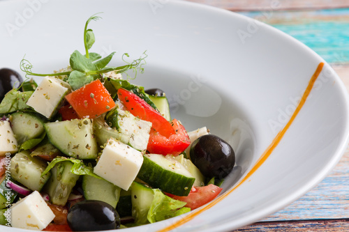 Fotografie, Obraz  fresh tasty greek salad appetizer on white plate