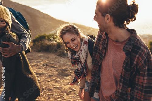 Young people having fun on hiking trip