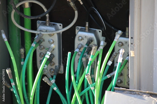 Fotografía  internet and cable coax cables replaced by glass fiber to speed up connection in