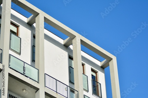 Fototapety, obrazy: Modern apartment buildings on a sunny day with a blue sky. Facade of a modern apartment building