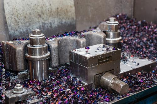 Fotografia, Obraz  Old machine with multi-colored metal sawdust. Metalworking.