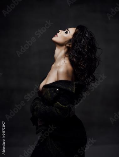 Obraz Young sensual beautiful sexy woman posing in summer fashion body jacket naked on dark  - fototapety do salonu