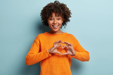 Lovely Young Woman Shows Heart...