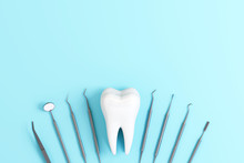 Dentist Tools With Teeth On Pastel Blue Background. 3d Rendering