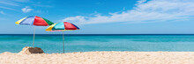 Two Umbrella On The Tropical Beach. Summer Holiday Banner