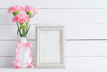 Valentines Day And Love Concept. Pink Carnation Flower In Vase With Old Vintage Picture Frame And Red Heart And On White Background.