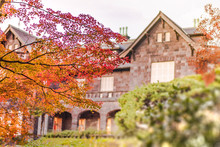 Sunset On Tokyo Metropolitan Park KyuFurukawa's Old Western-style Mansion At Red Maple Momiji Leaves Season In Autumn.