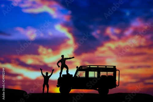 Miniature toys of two men celebrate triumphantly at the mountain concept at sunset or sunrise Canvas Print