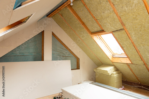 Obraz House attic insulation and renovation. Drywall construction - fototapety do salonu