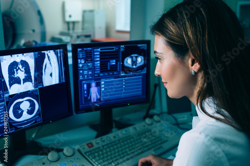 Radiologist reading a CT scan Canvas Print