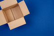 canvas print picture - Open empty cardboard boxes on blue background