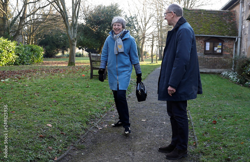 9585c3f78775 Britain s Prime Minister Theresa May and her husband Philip leave a church