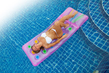 Woman On Air Mattress In Swimm...