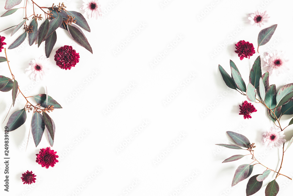 Fototapeta Flowers composition. Eucalyptus leaves and pink flowers on white background. Flat lay, top view, copy space