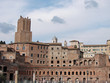 Forum of Cesari in Rome with Trajan's Column and church in background