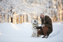 Full Length Portrait Of Mature Man Posing With Dog In Beautiful Winter Park, Copy Space