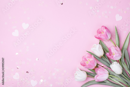 Obraz Spring tulip flowers on pastel pink background top view. Greeting card for International Women Day, Mother day. Flat lay. - fototapety do salonu
