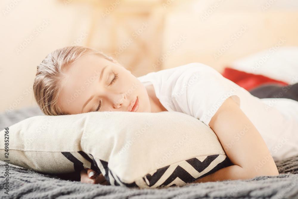 Fototapeta Beautiful young woman sleeping in bed white shirt. Concept useful daytime sleep