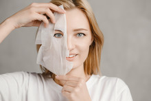 Beautiful Portrait Of Young Girl In Facial Mask For Face. Cosmetic Procedure Skin Care