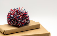 Pom Pom On Brown Paper Gifts