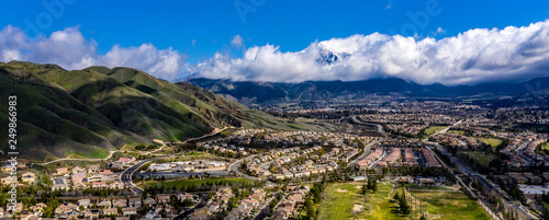 Türaufkleber Barcelona Aerial, done view of white clouds over Mount San Gorgonio in the San Bernardino Mountains and blue sky above Yucaipa, California after a rain storm