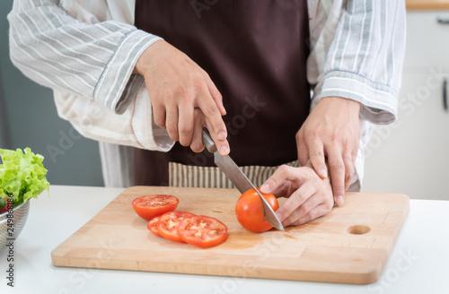 Autocollant pour porte Cuisine Sweet gay couple preparing food