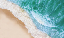 Top View Of Beautiful Sand Beach With Turquoise Sea Water,Wave Propagation,aerial View From Drone Camera / Summer Concept.