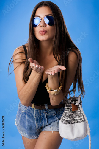 Fotografie, Obraz  Studio portrait of stylish pretty positive brunette girl showing gesture of good and super by big finger, everything right