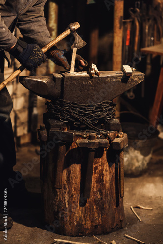 blacksmith splits firewood for kindling the furnace. Wallpaper Mural