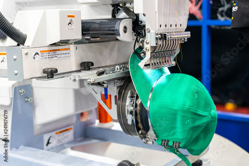 Photo Hat sewing at modern and automatic high technology  embroidery machine for texti