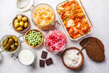 Probiotics Food Concept. Kimchi, Beet Sauerkraut, Sauerkraut, Cottage Cheese, Peas, Olives, Bread, Chocolate, Kefir And Pickled Cucumbers.