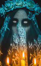 Scary Corpse Zombie Bride With White Empty Eyes And Candles On Black Background