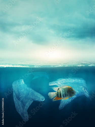 Vászonkép Plastic bag with a fish in the ocean