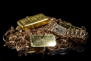 A pile of gold bars and gol...