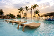 Leinwanddruck Bild - luxury swimming pool on sea view and chair in hotel resort with sunrise time