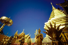 Buddhist Temple In Thailand Wat Pra That Doi Suthep With Golden Statues Adorning