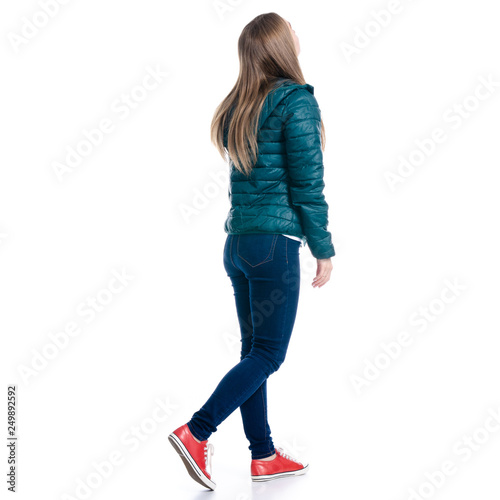Fotografía  Woman in jeans and jacket walking goes looking on white background