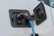 Battery of electric car charged with charging cable plug